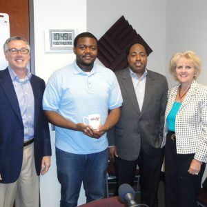 Sue McCart with HFI Event Services, Gavin McGuire and Rashad Cain with Usher's New Look Foundation and Monty Hamilton with Rural Sourcing