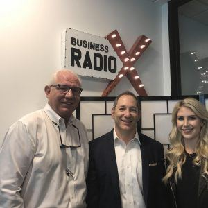 Bill Coons with Facilitec, Gregory Silberman with ACG Wealth, and Katherine Mason with SculptHouse