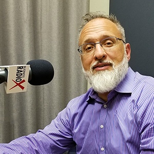 Linc Miller with Sandler Training in the studio at Valley Business RadioX in Phoenix, Arizona