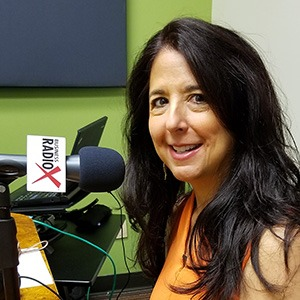 Karen Jacobson in the studio at Valley Business RadioX in Phoenix, Arizona