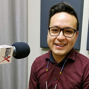 Brian Garcia with Tempe Union High School Districtin the studio at Valley Business RadioX in Phoenix, Arizona