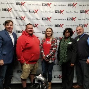 Dan Bevels of Floyd Medical Center, Patsy Wade of Heyman Hospice Care at Floyd, Hannah White of Fast Printing and Signs, and Eric McJunkin of Brewhouse Music and Grill