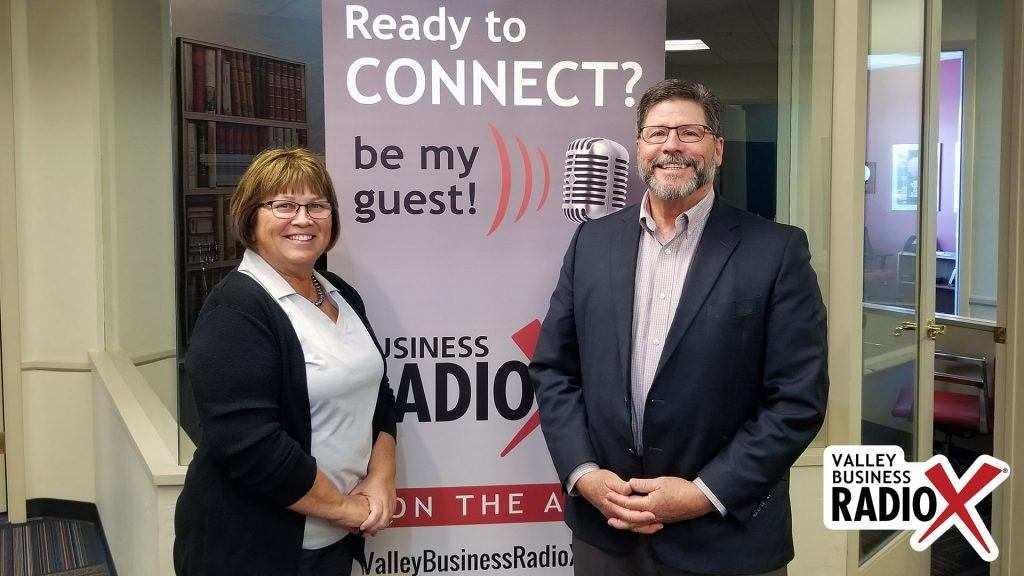 Brenda Martinez and Tom Davis with the Land Title Association of Arizona, Pioneer Title Agency, and Yavapai Title Agency visit the Valley Business Radio studio in Phoenix, Arizona