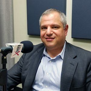 Dr. Roland Segal in the studio at Valley Business RadioX in Phoenix, Arizona